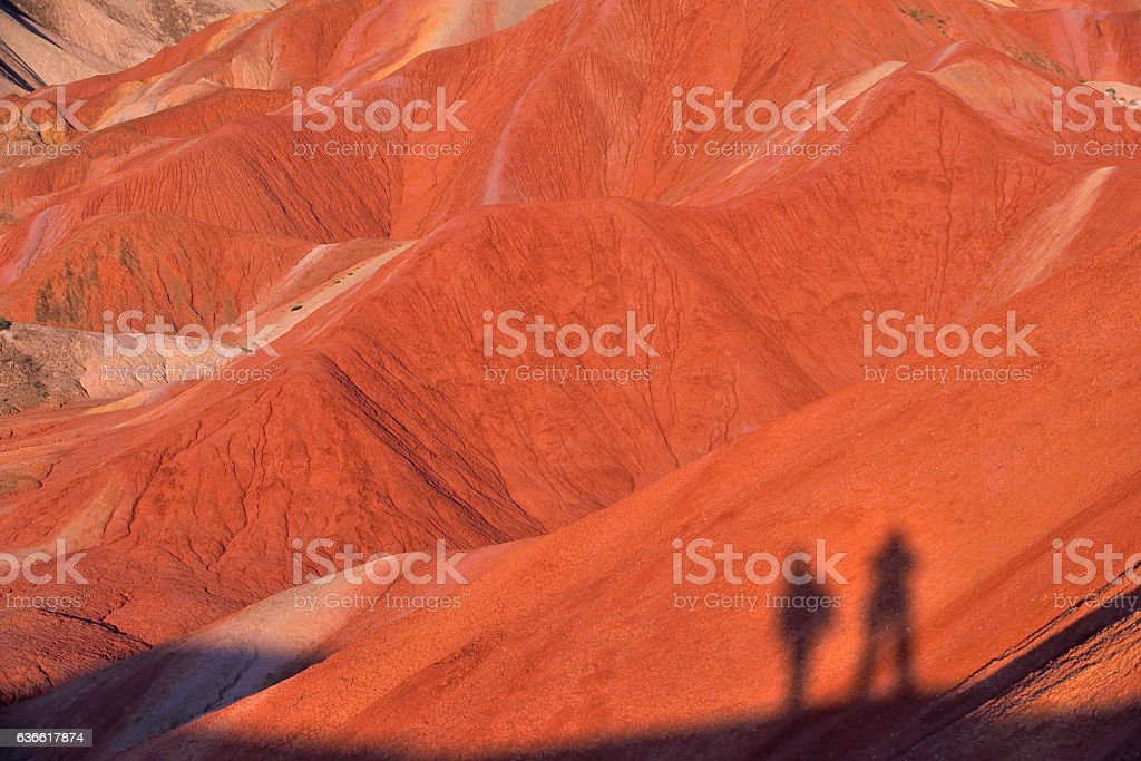 Red Hills and Human Silhouettes stock photo
