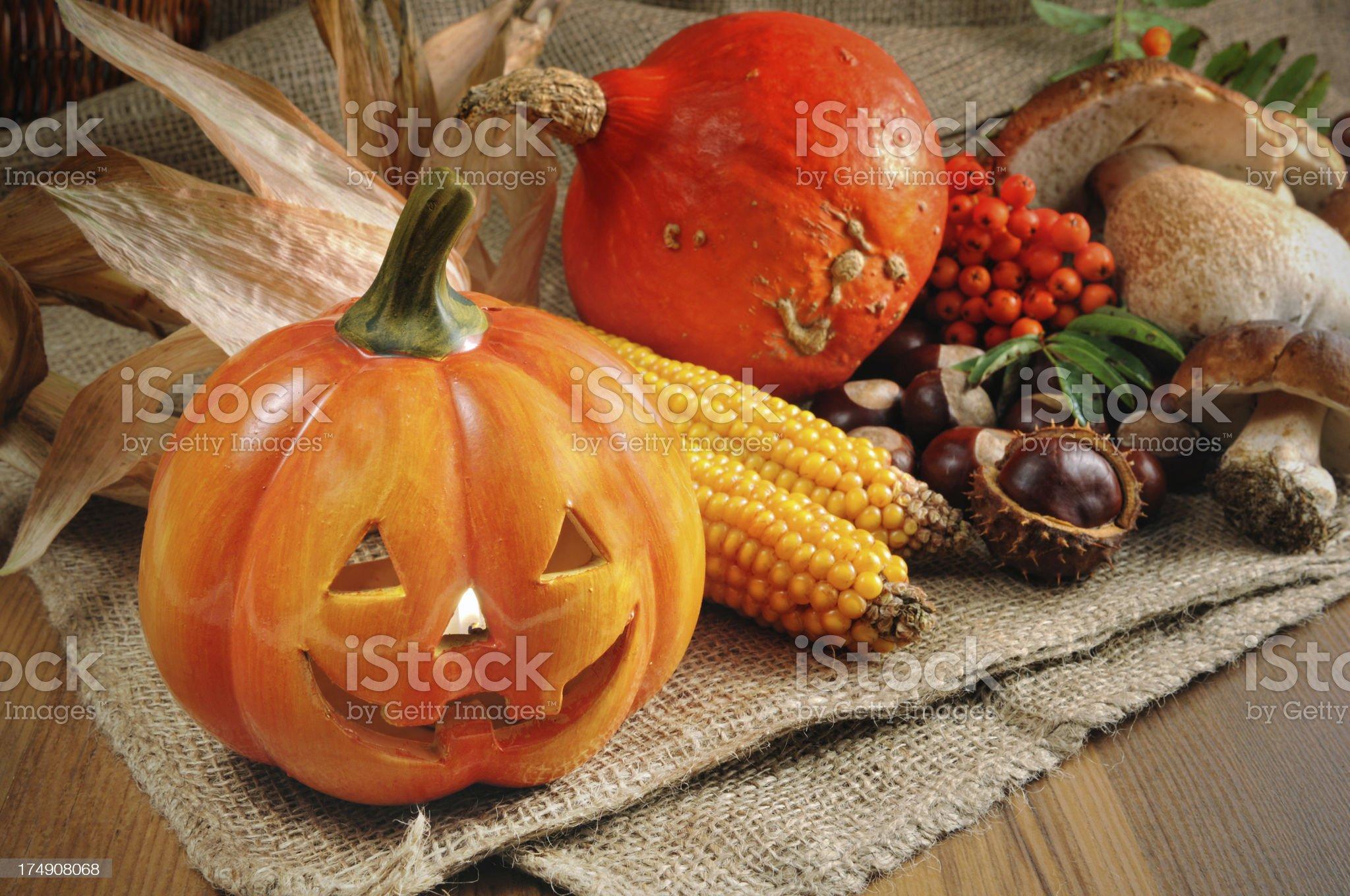 Red Hokkaido halloween pumpkin with chestnuts and mushroom royalty-free stock photo