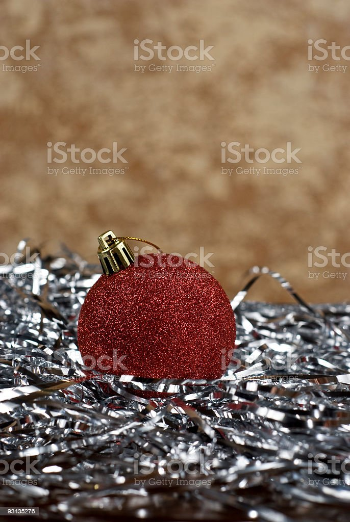 Red Holiday Bulb on Silver Tinsel royalty-free stock photo