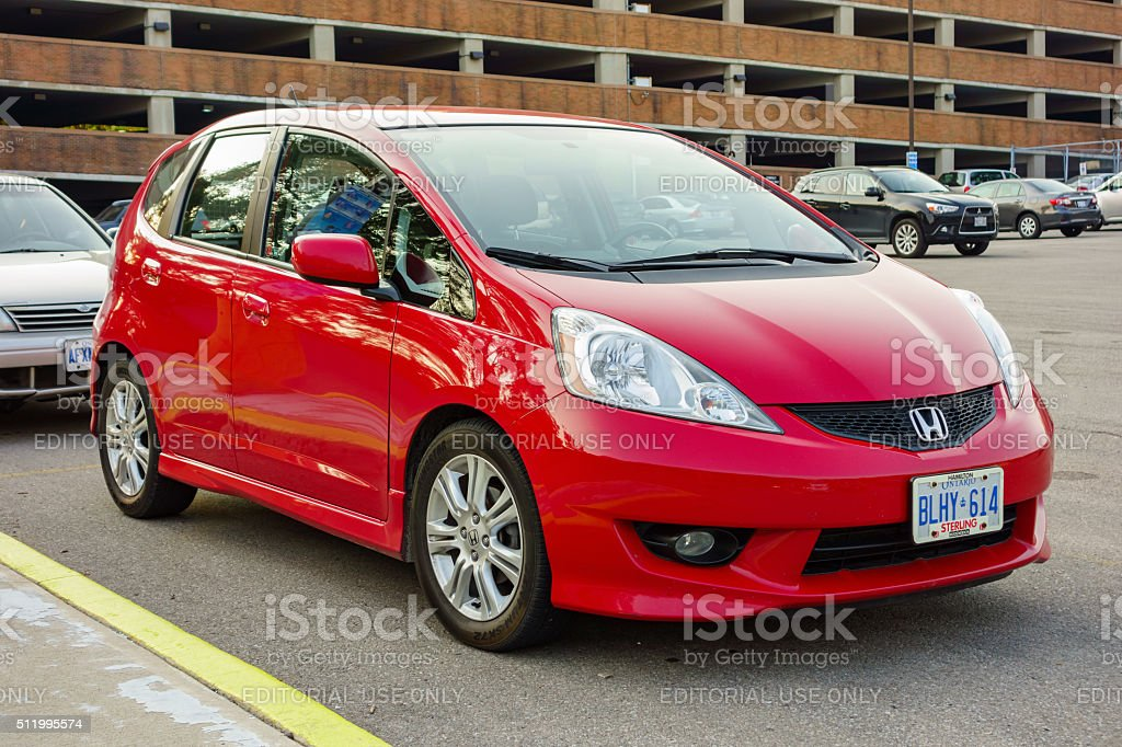 Red Honda Fit stock photo