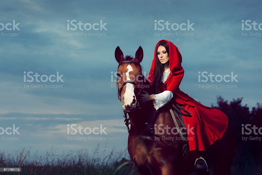 Red Hood Princess Riding a Horse stock photo