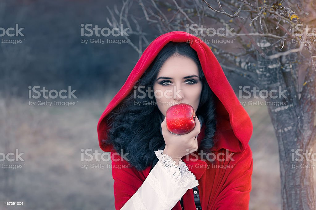 Red Hooded Woman Holding Apple Fairytale Portrait stock photo