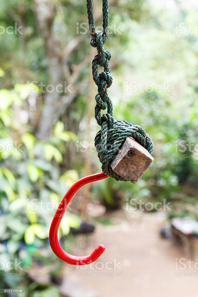 Red hook tied with nylon rope. stock photo