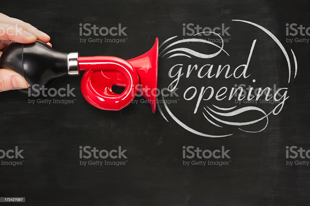 Red horn or trumpet announces GRAND OPENING stock photo