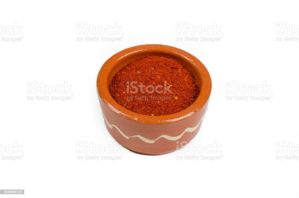 Red hot cayenne pepper in a cup or bowl stock photo