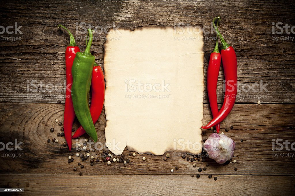 Red Hot Chili Peppers with the Old Paper sheet royalty-free stock photo