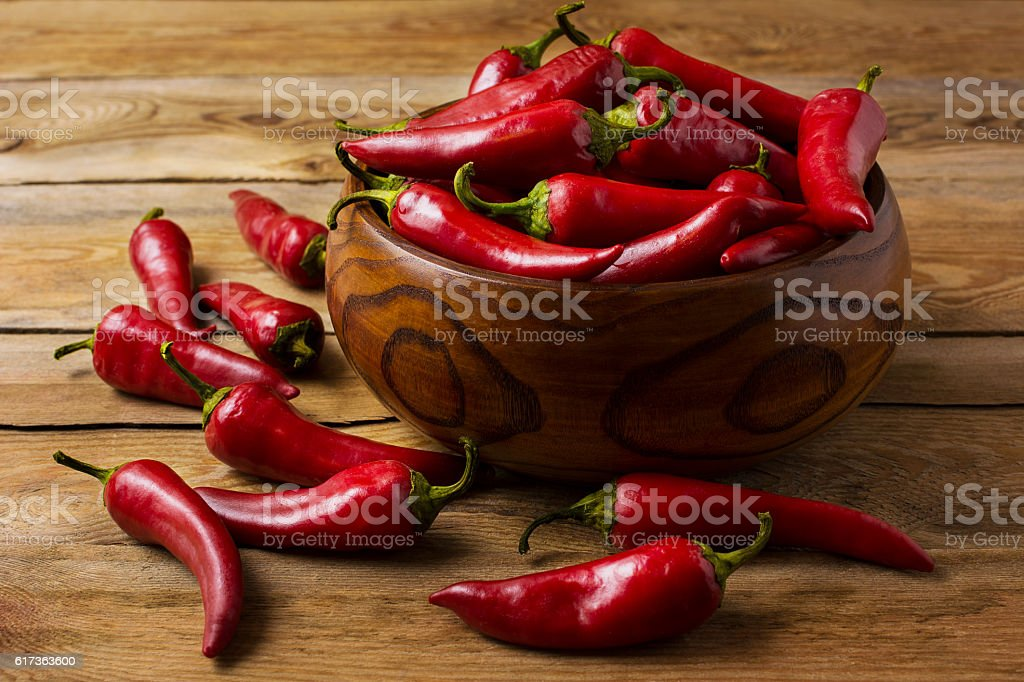 Red hot chilli pepper in wooden bowl stock photo