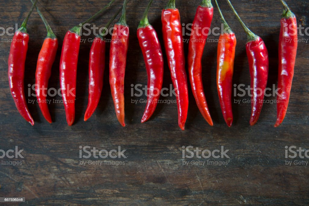 Red hot chilli pepper on wooden tabel background stock photo