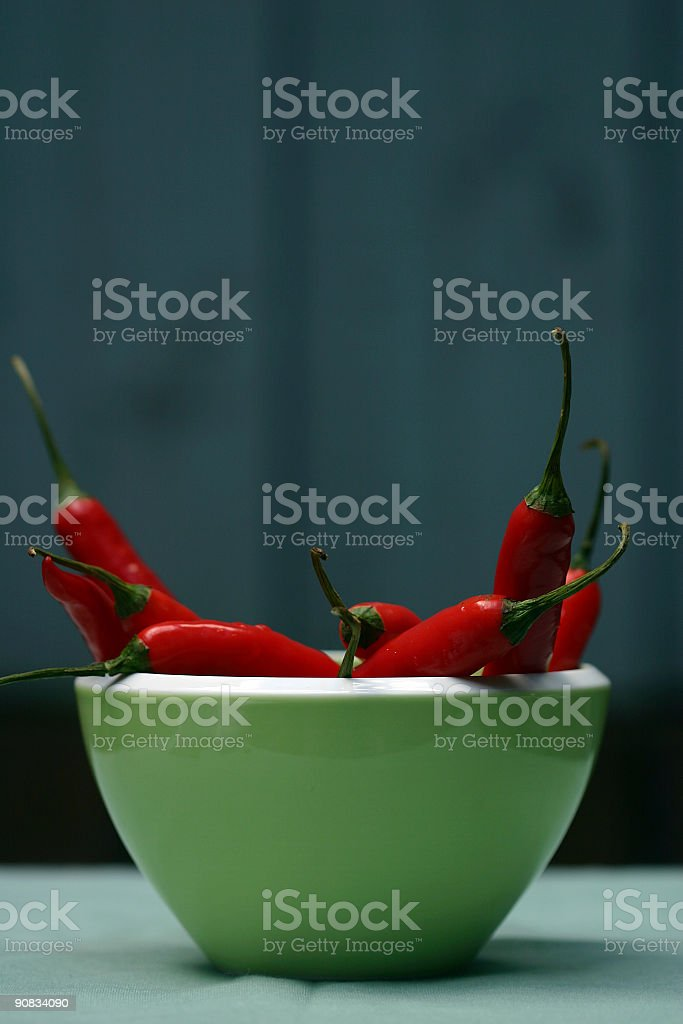 red hot chillies in a green bowl royalty-free stock photo