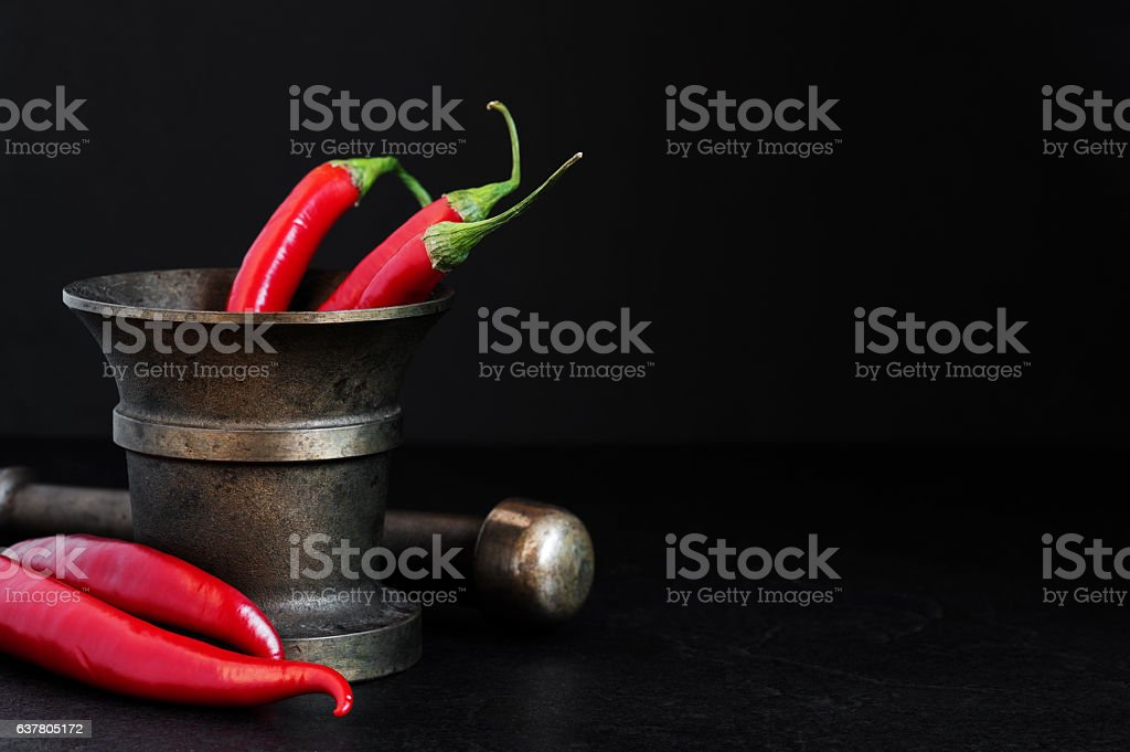 Red hot peppers in the old pounder stock photo