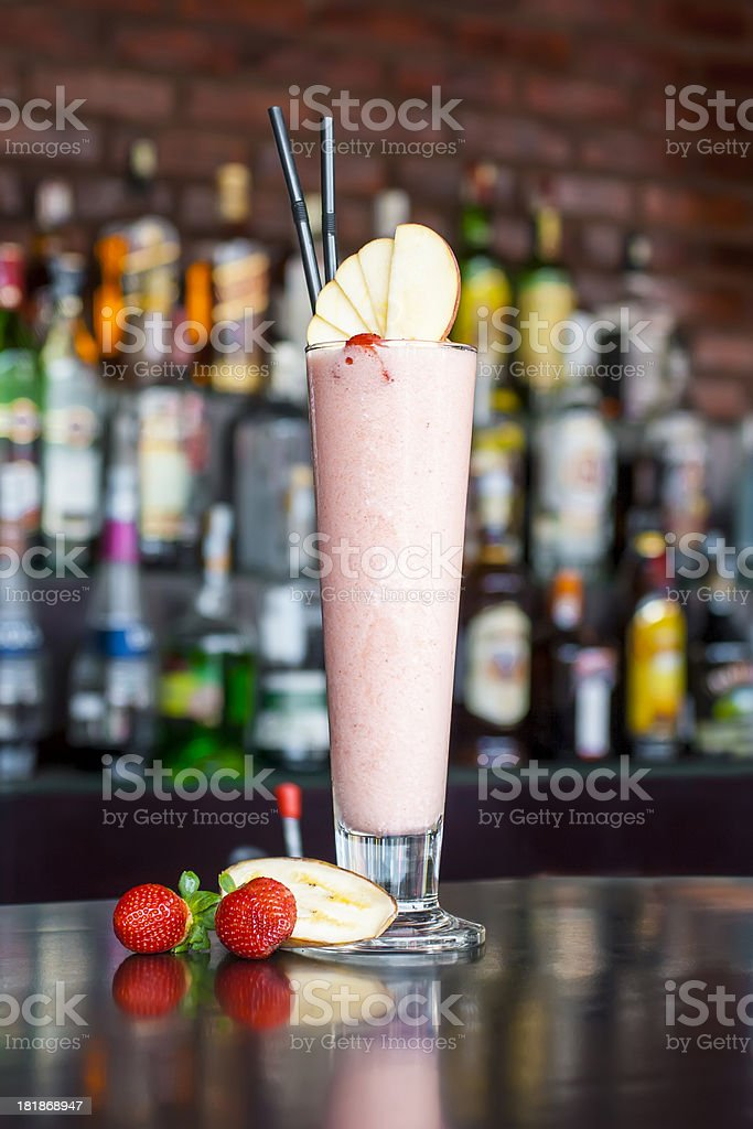 Red Houp cocktail near on the  classic black bar table stock photo