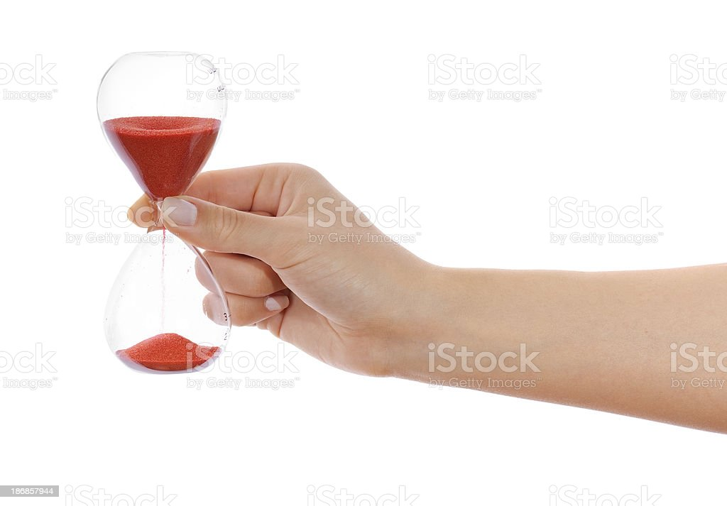 Red hourglass in woman hand on white royalty-free stock photo