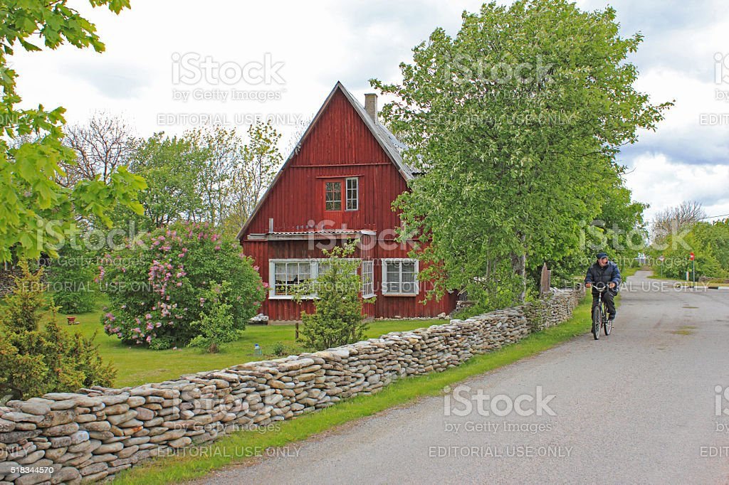 Red house by the road stock photo