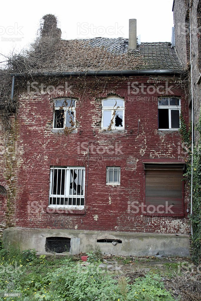 red house in ruin stock photo