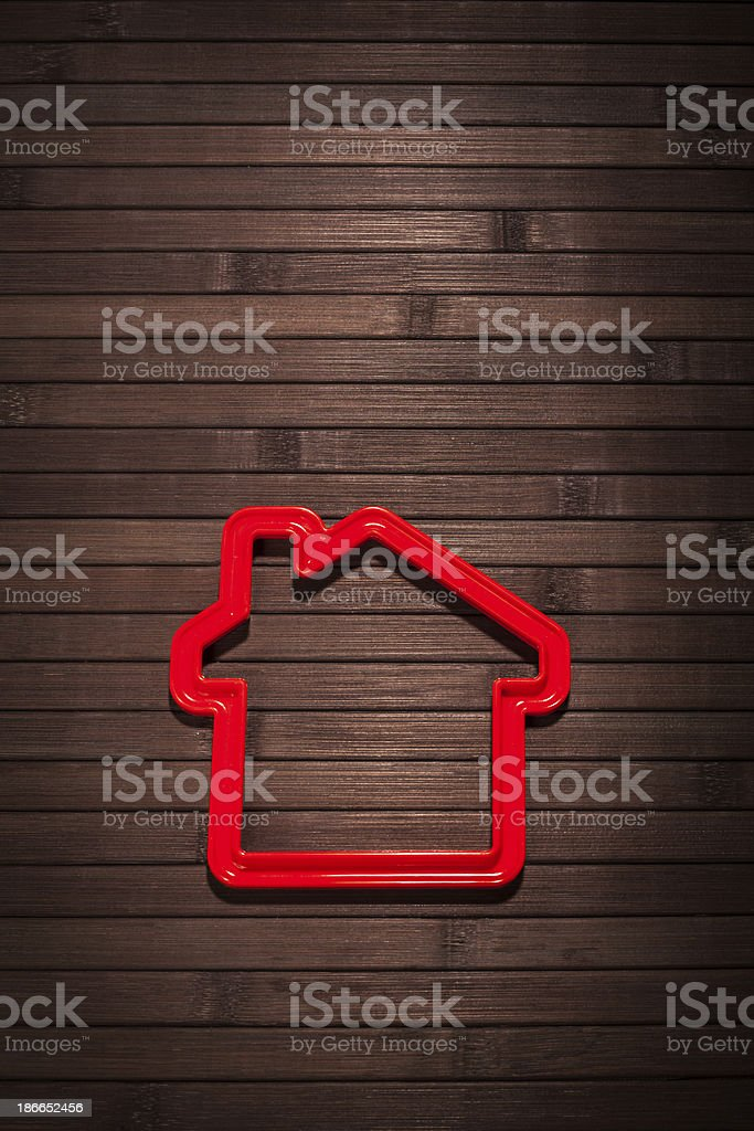 red house on a wooden background stock photo
