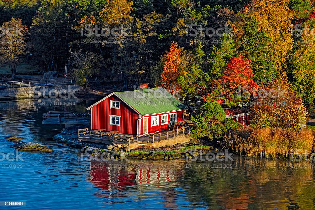Red house on rocky shore of Ruissalo island, Finland stock photo