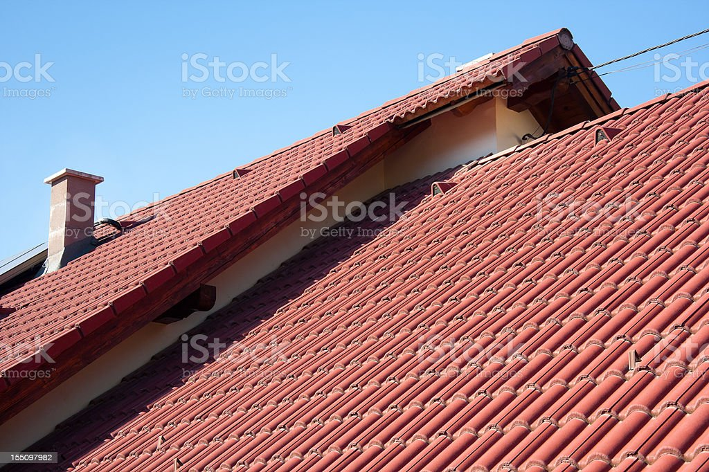 A red house roof on a sunny day royalty-free stock photo