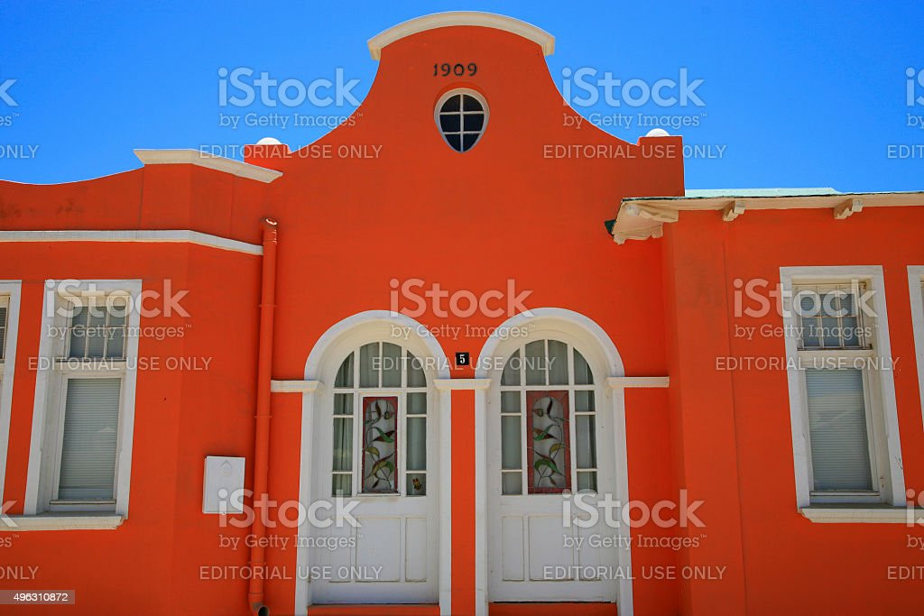 Red house traditional house with a blue sky in Luderitz stock photo