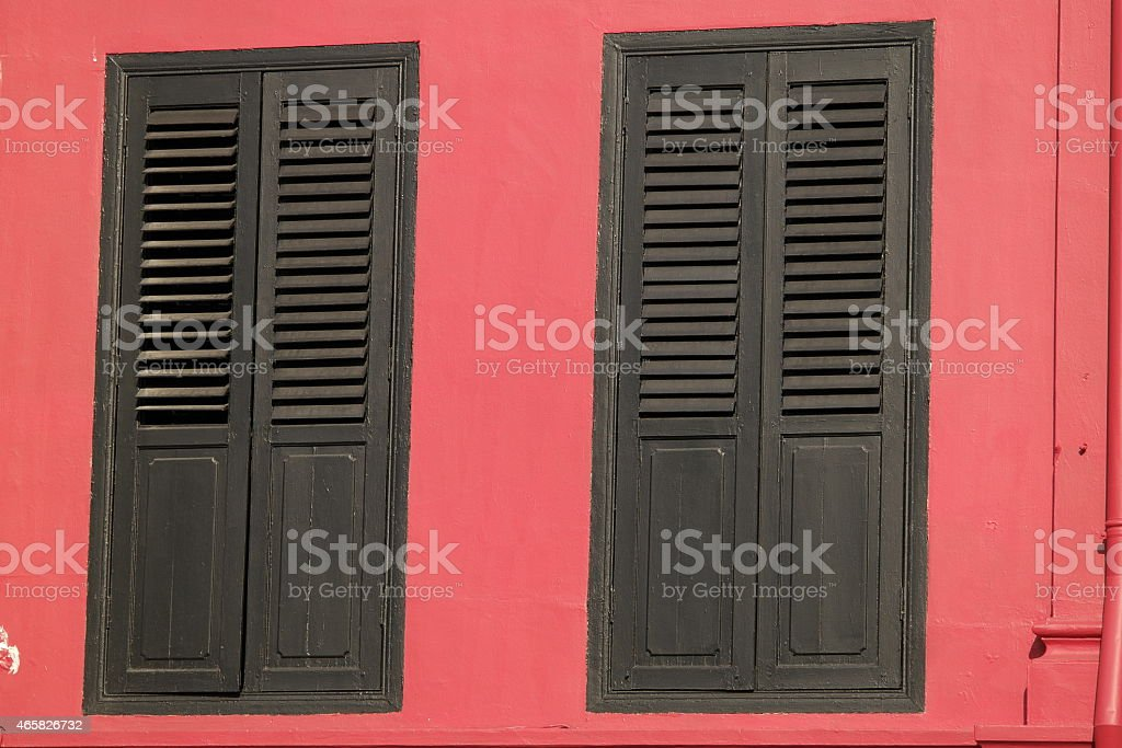 Red house with brown shutter stock photo