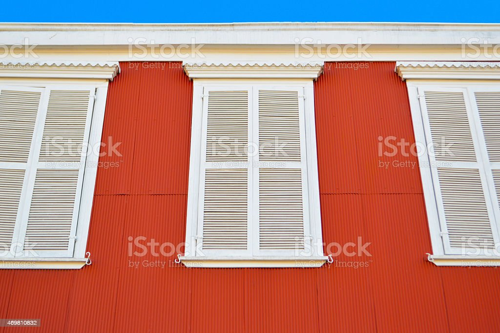 Red house with white windows in valparaiso stock photo