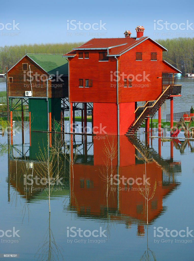 Red houses and flooding river stock photo