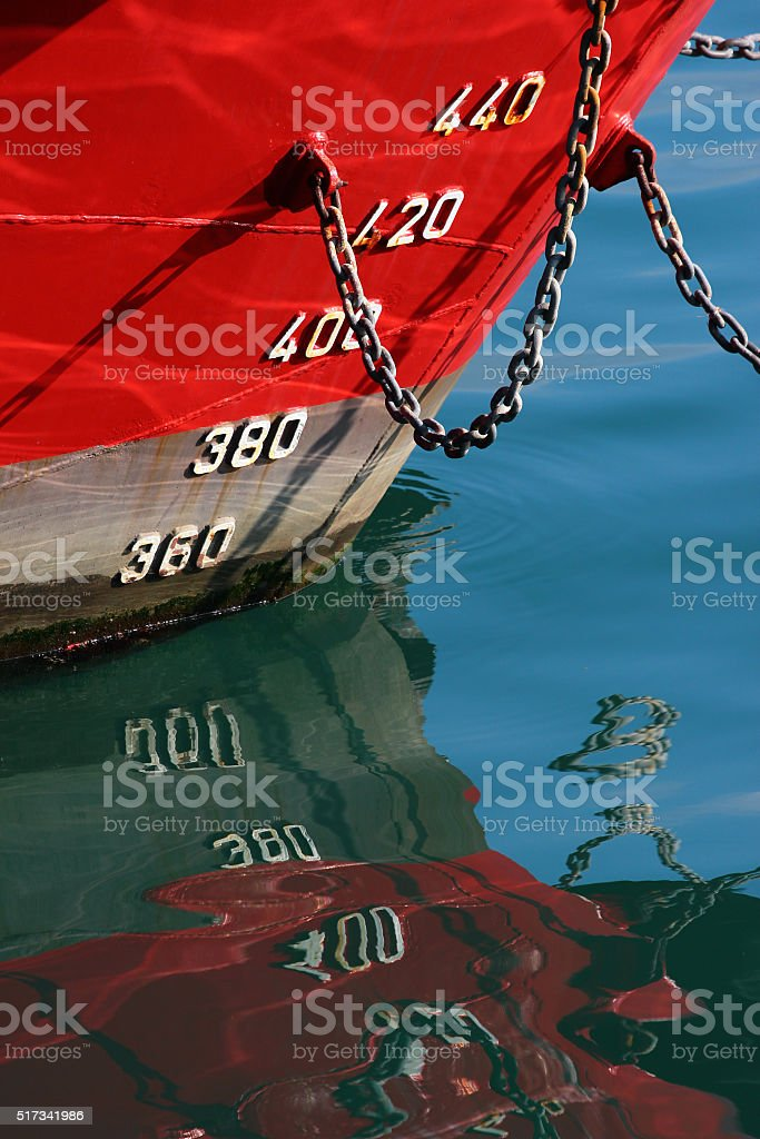 Red hull of a ship stock photo
