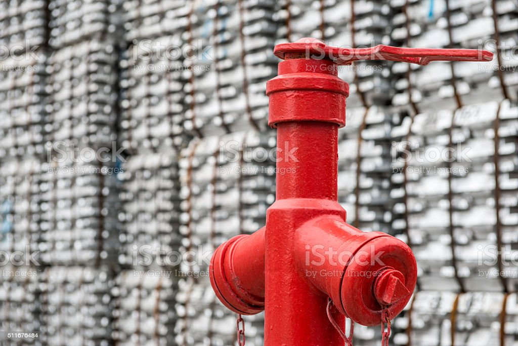 red hydrant in factory stock photo