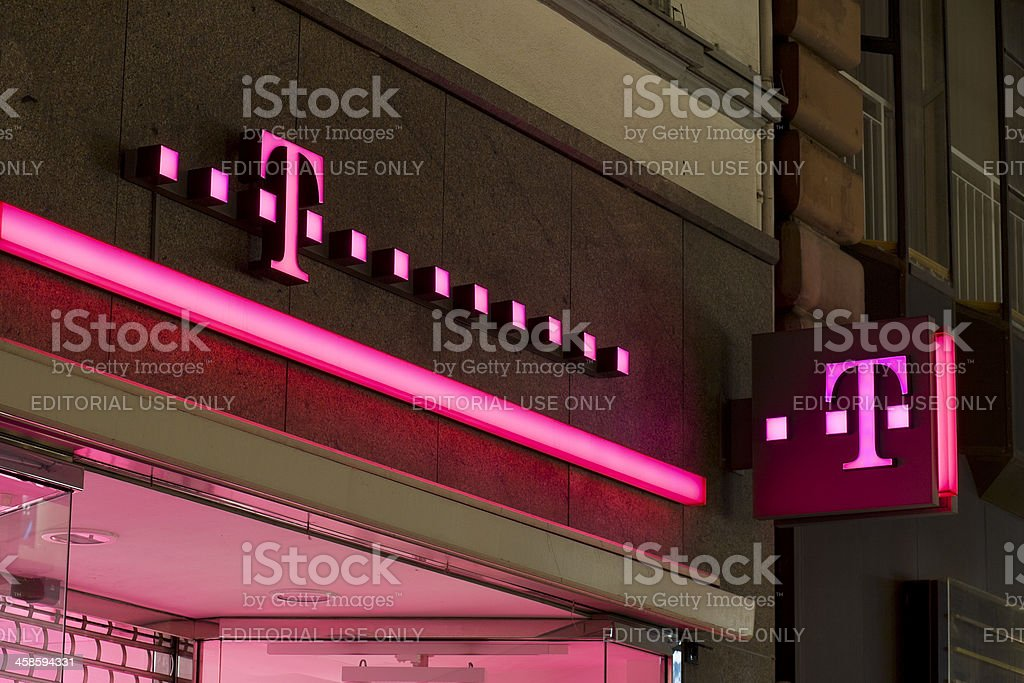 Red Illuminated sign of Telekom Shop stock photo