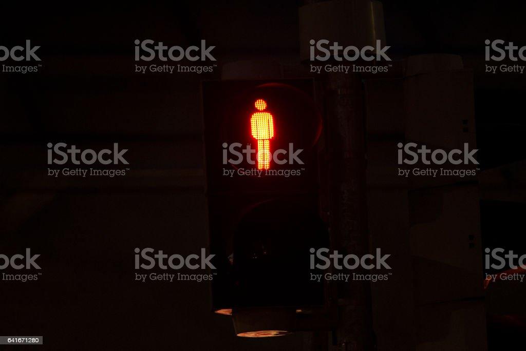 A red illuminated walk street pedestrian signal stock photo