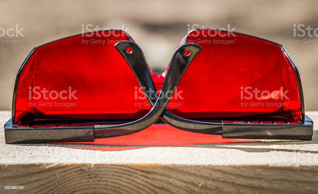 Red industrial sunglasses stock photo