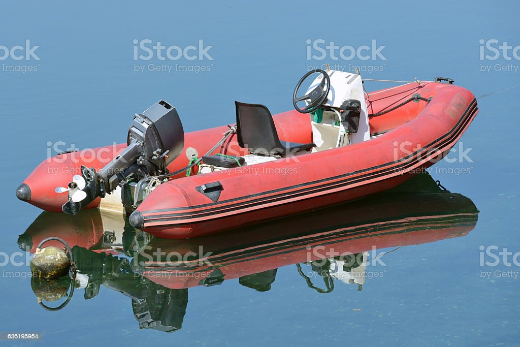red inflatable boat with motor stock photo