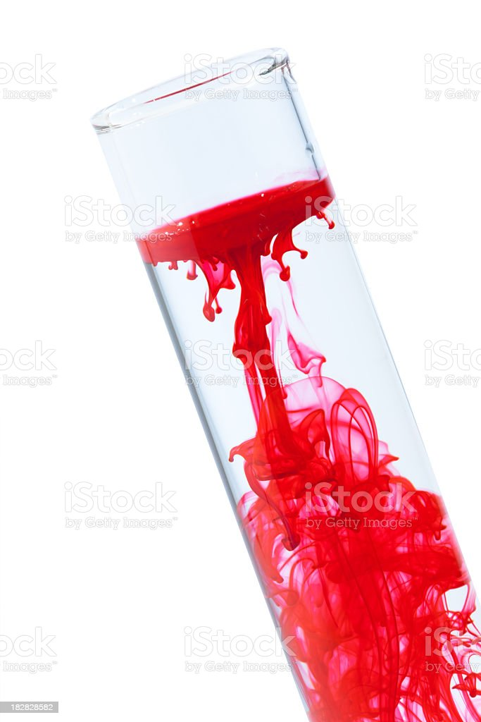 Red ink dropped into water in a test tube stock photo
