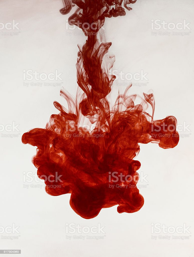 red ink in water. abstract background stock photo