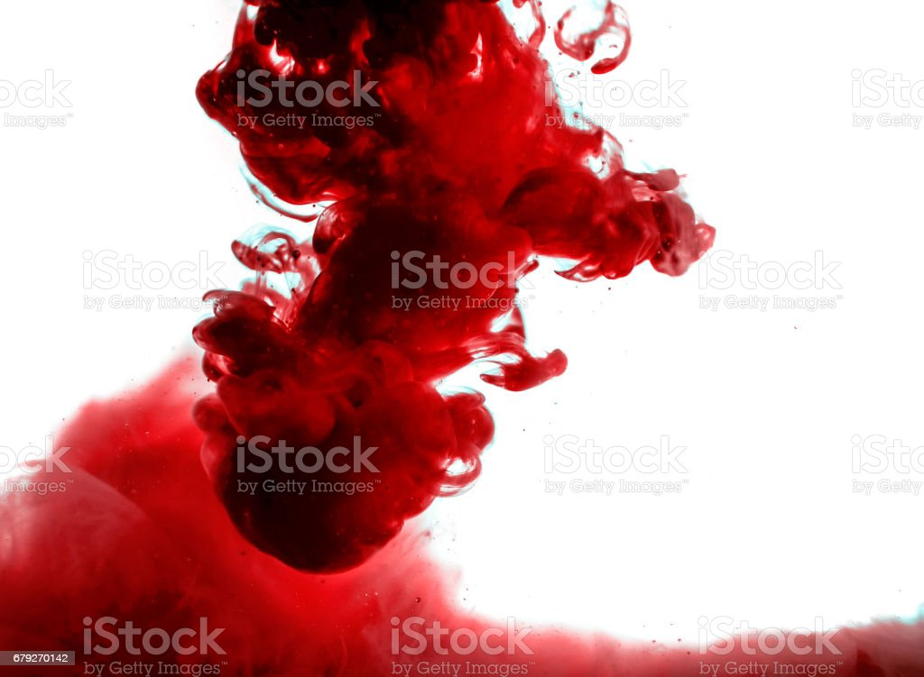 red ink in water isolated on white background stock photo