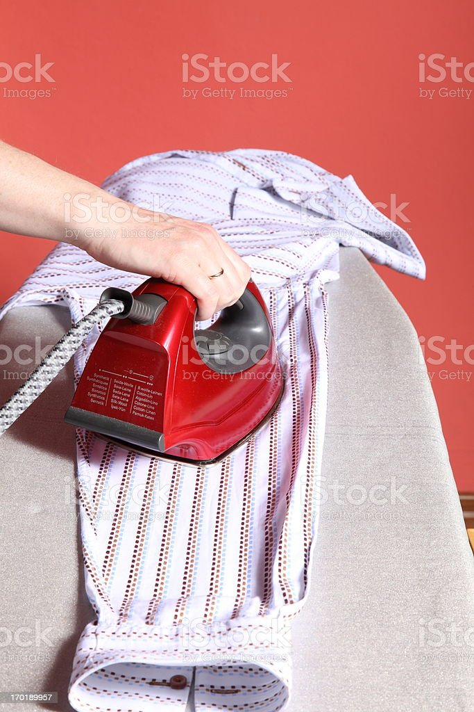 red Iron in hand and  shirt royalty-free stock photo