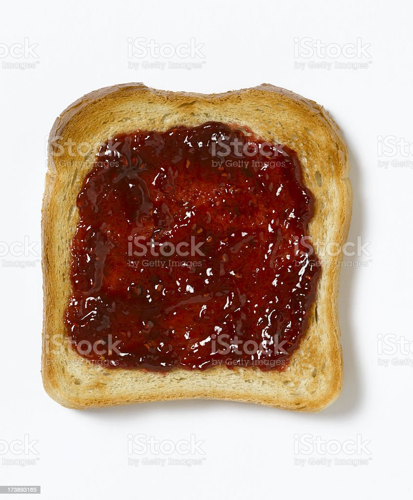 Red jam spread evenly onto a piece of toast royalty-free stock photo