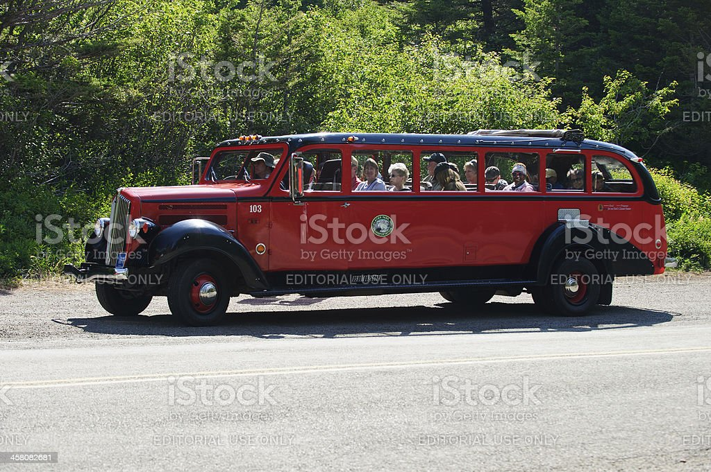 Red Jammer bus full of tourists royalty-free stock photo