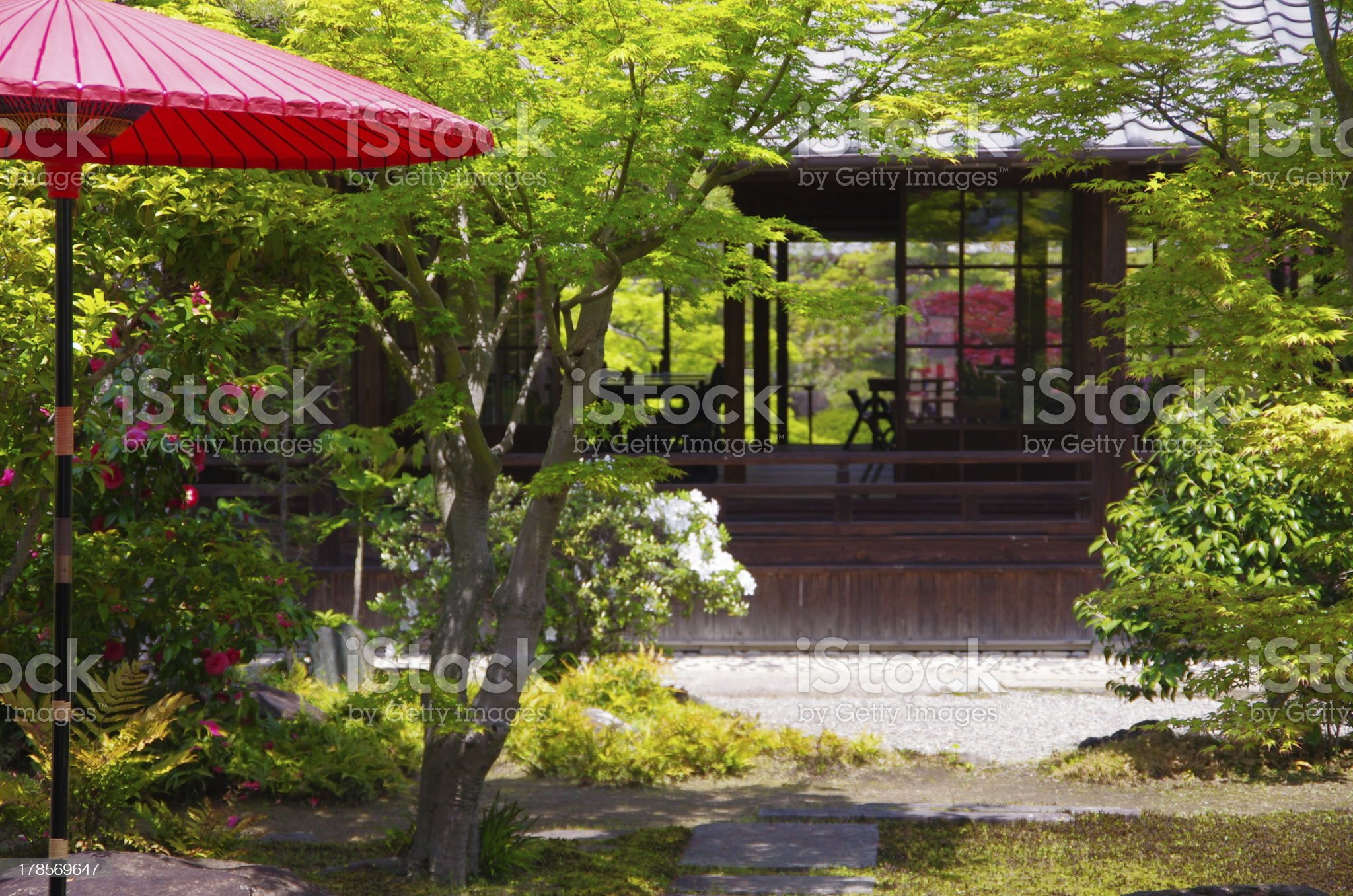 red Japanese umbrella (parasol) and traditional house royalty-free stock photo