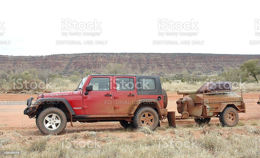 Red Jeep Wrangler and trailer, Mereenie Loop, Northern Territory royalty-free stock photo