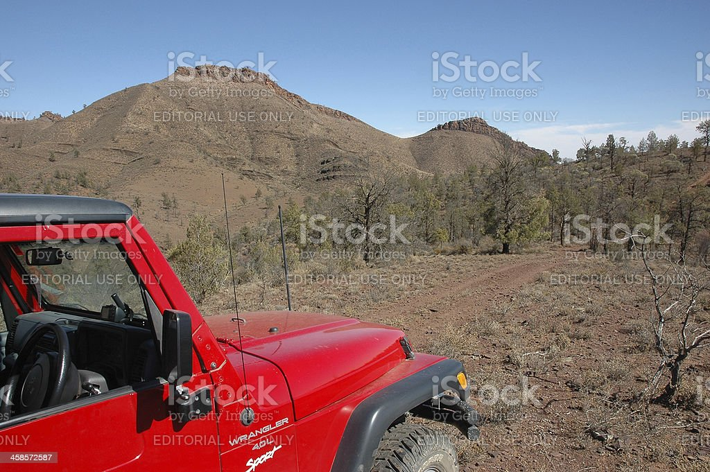 Red Jeep Wrangler driving offroad rocky track in Flinders Ranges stock photo