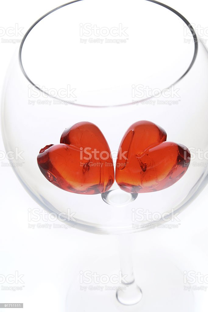 red jelly hearts and a  wine glass royalty-free stock photo