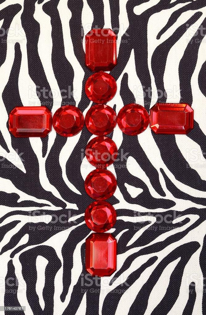 Red Jewel Cross on Zebra Pattern royalty-free stock photo
