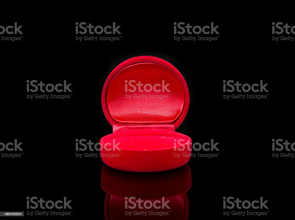Red jewelry box isolated on black stock photo