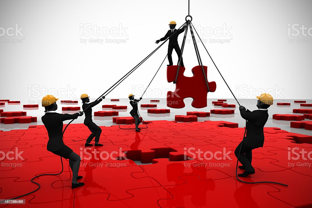 Red Jigsaw puzzle built by teamwork of executives stock photo