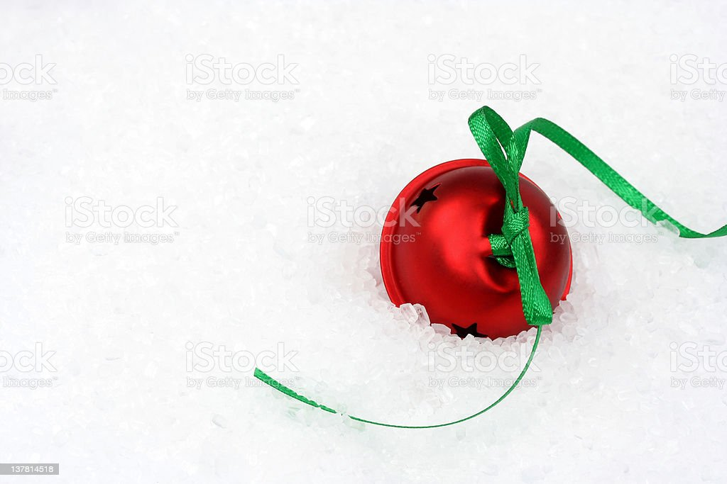 Red Jingle Bell in Snow stock photo