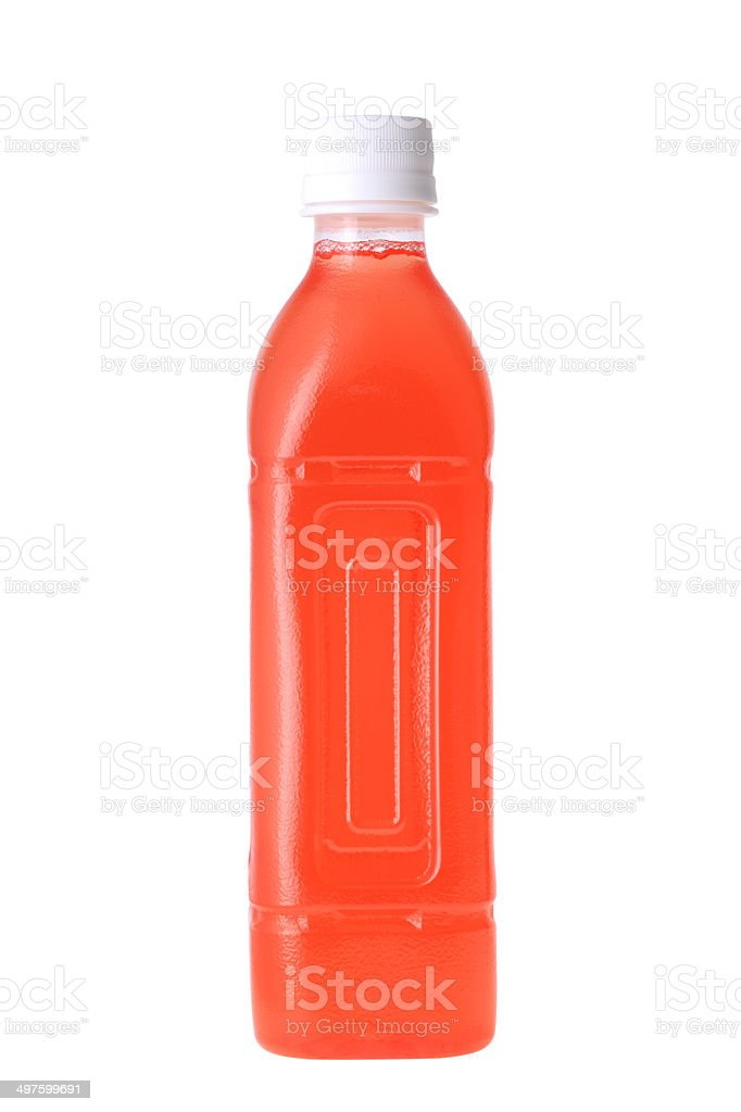 red juice in a bottle stock photo