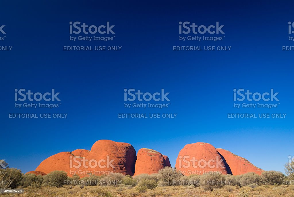 Red Kata Tjuta (Olgas) rock formation and clear blue sky stock photo