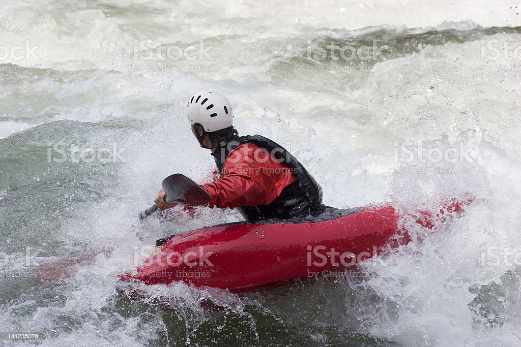 Red kayak in action stock photo