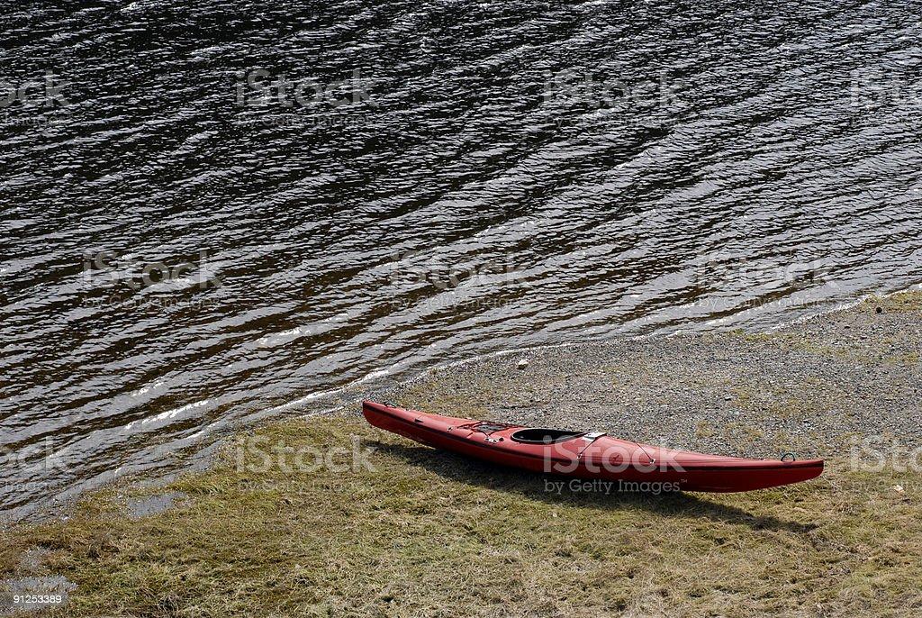 Red kayak near lake royalty-free stock photo