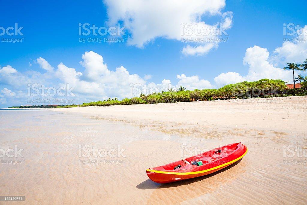 Red kayak on beach stock photo
